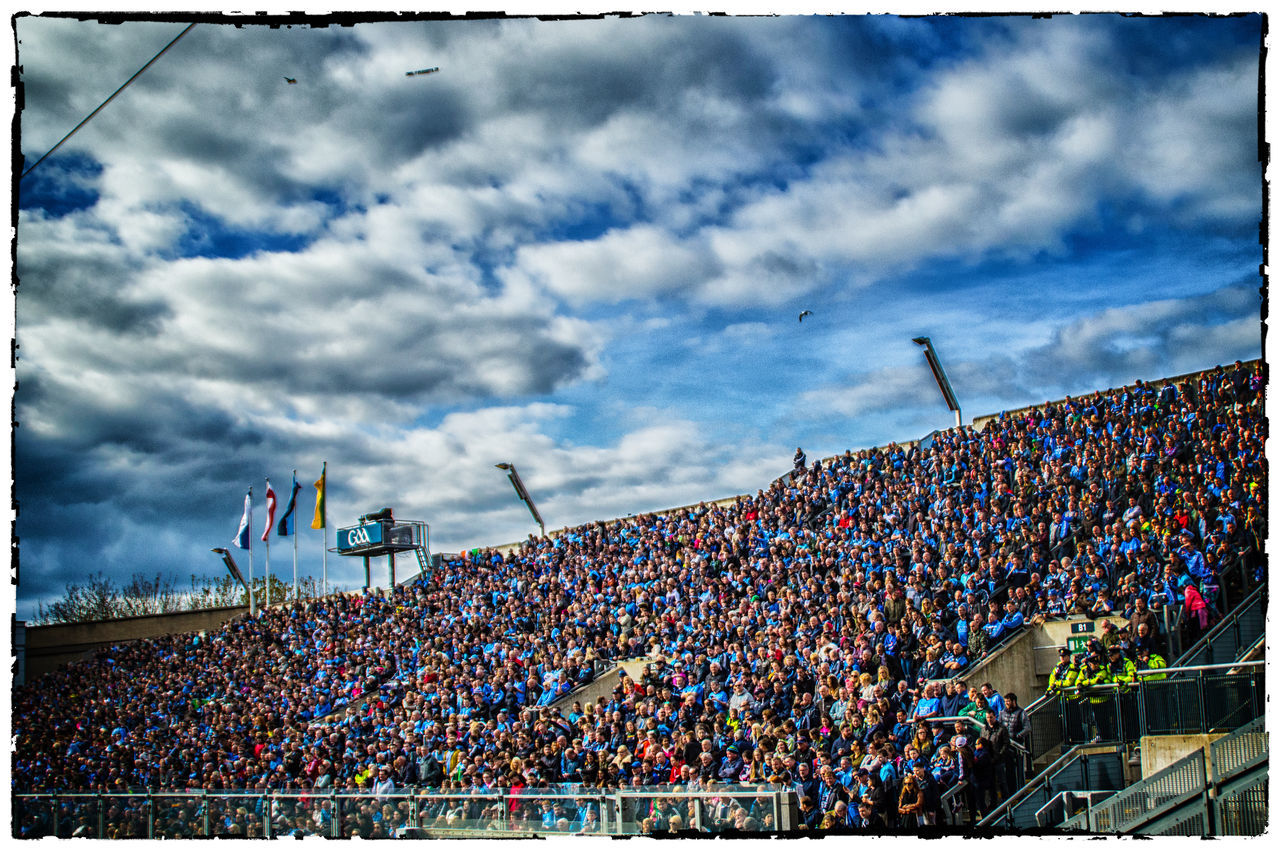 crowd, spectator, cloud - sky, stadium, sky, day, large group of people, panoramic, outdoors, fan - enthusiast, togetherness, audience, water, people