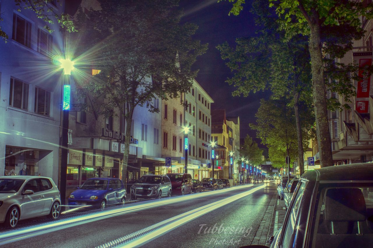 street, transportation, road, illuminated, city, car, motion, night, architecture, no people, outdoors