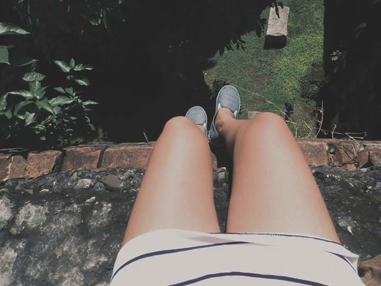 low section, human leg, one person, real people, personal perspective, human foot, outdoors, human body part, day, barefoot, shoe, rock - object, women, leisure activity, lifestyles, nature, retaining wall, tree, close-up, people