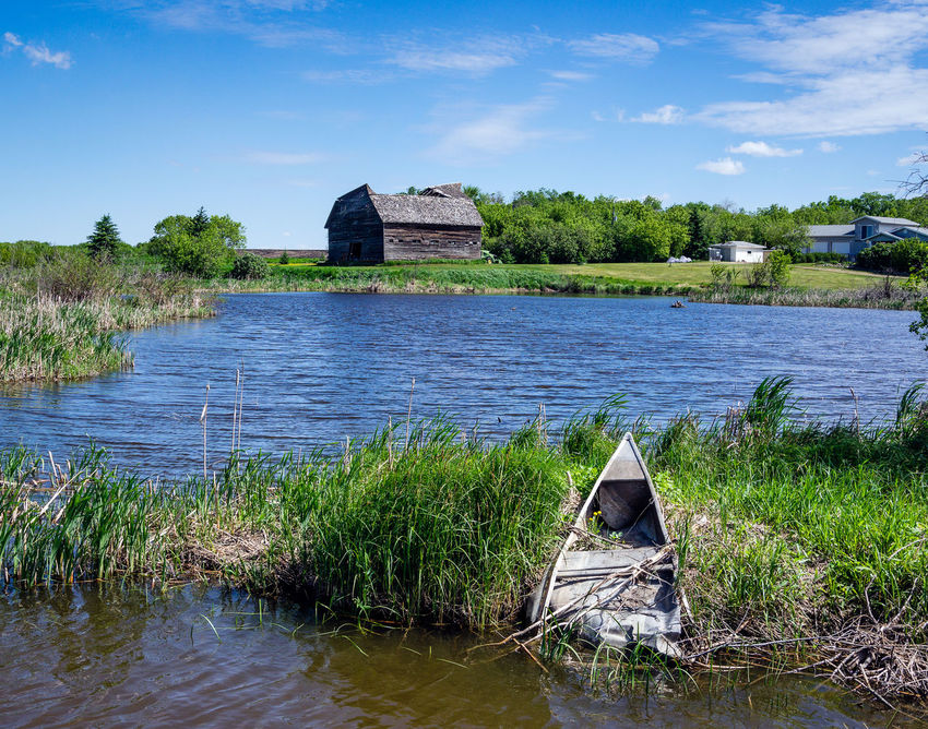 Architecture Beauty In Nature Boat Building Exterior Built Structure Cloud - Sky Day Grass Lake Nature No People Old Barn Outdoors Sky Tranquility Tree Water