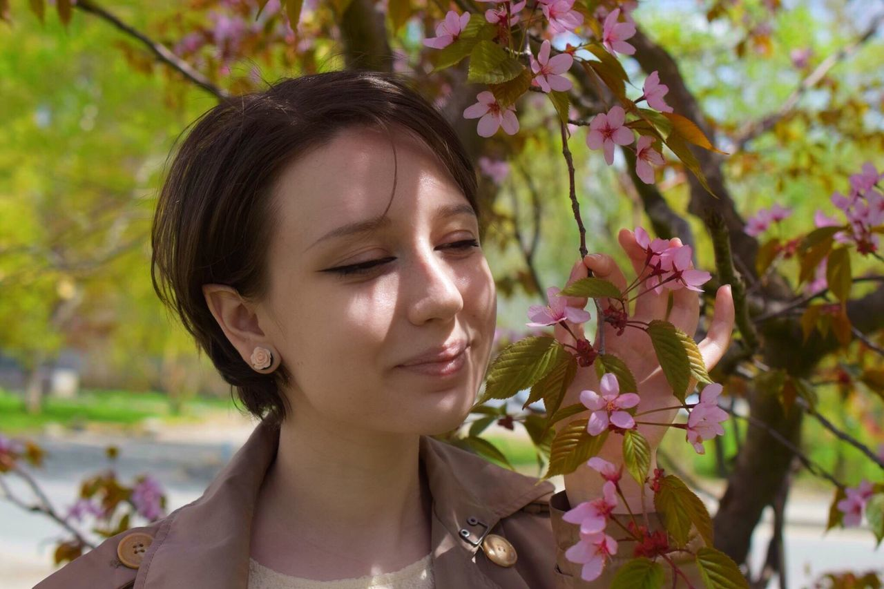 Flower Nature Fragility Young Adult Focus On Foreground One Person Tree Growth Eyes Closed  Beauty In Nature Young Women Petal Day Outdoors Plant Beautiful Woman Park - Man Made Space Close-up Branch Real People