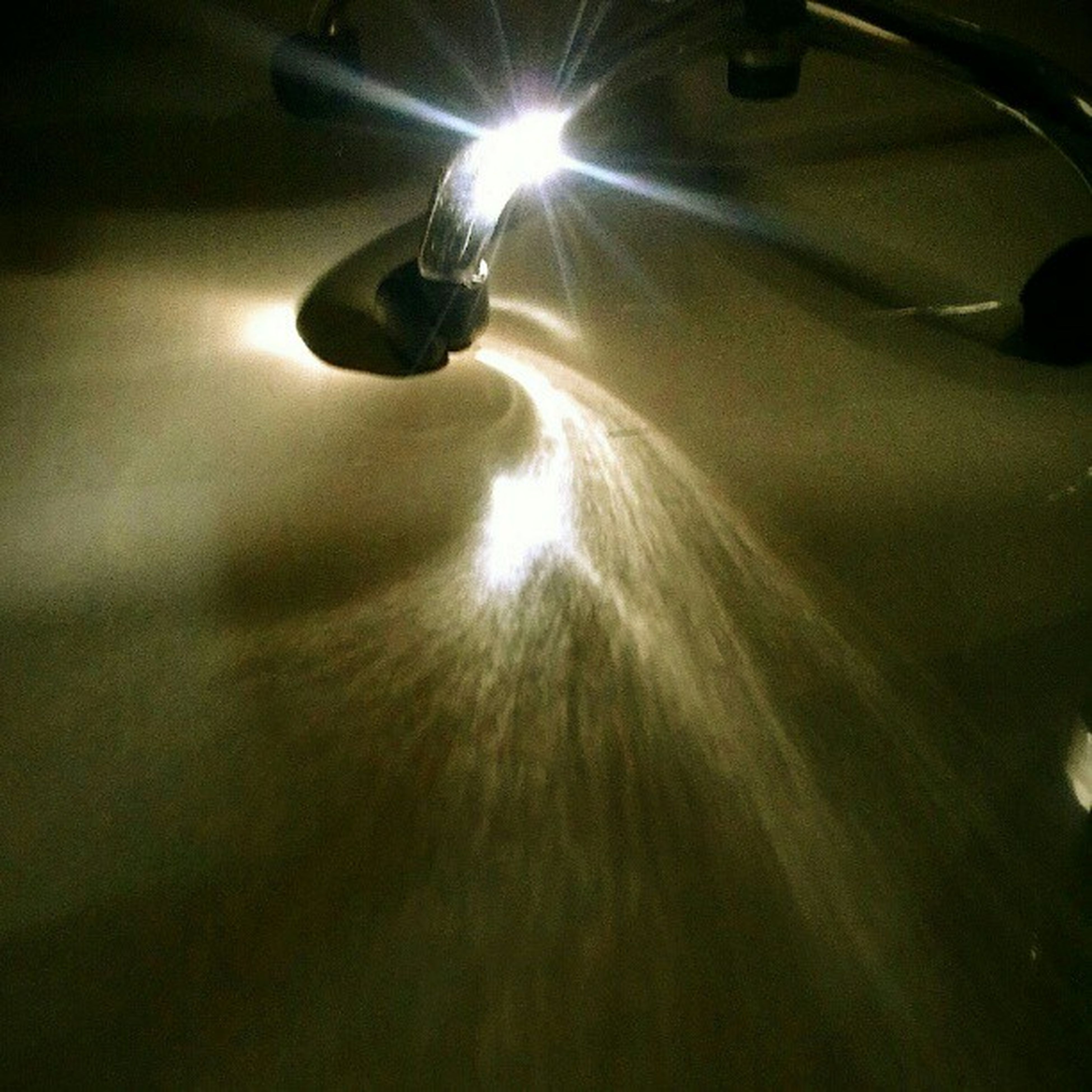 lens flare, sun, sunbeam, sunlight, night, glowing, low angle view, light - natural phenomenon, no people, illuminated, bright, sunny, outdoors, close-up, nature, shiny, lighting equipment, back lit