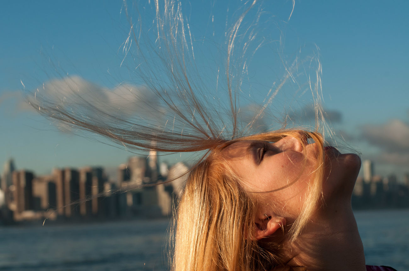 Architecture Blond Hair City Eye4photography  EyeEm Best Shots EyeEm Gallery Focus On Foreground Lifestyles Long Hair Outdoors Sky Sunset The Portraitist - 2017 EyeEm Awards Water Young Women