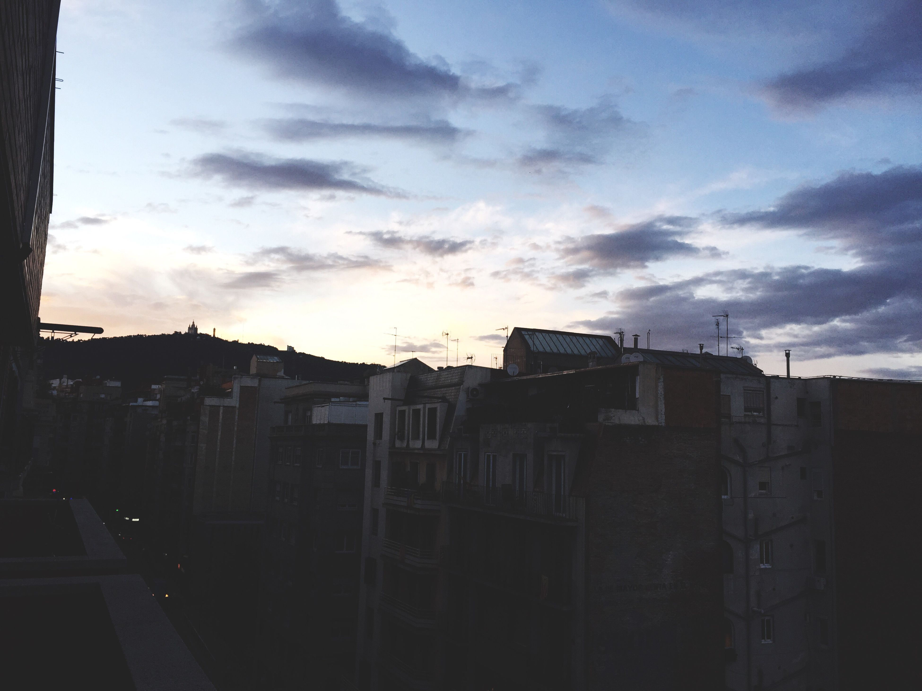 architecture, building exterior, built structure, sky, cloud - sky, sunset, building, cloud, city, residential structure, residential building, silhouette, cloudy, house, outdoors, no people, low angle view, sunlight, dusk, day