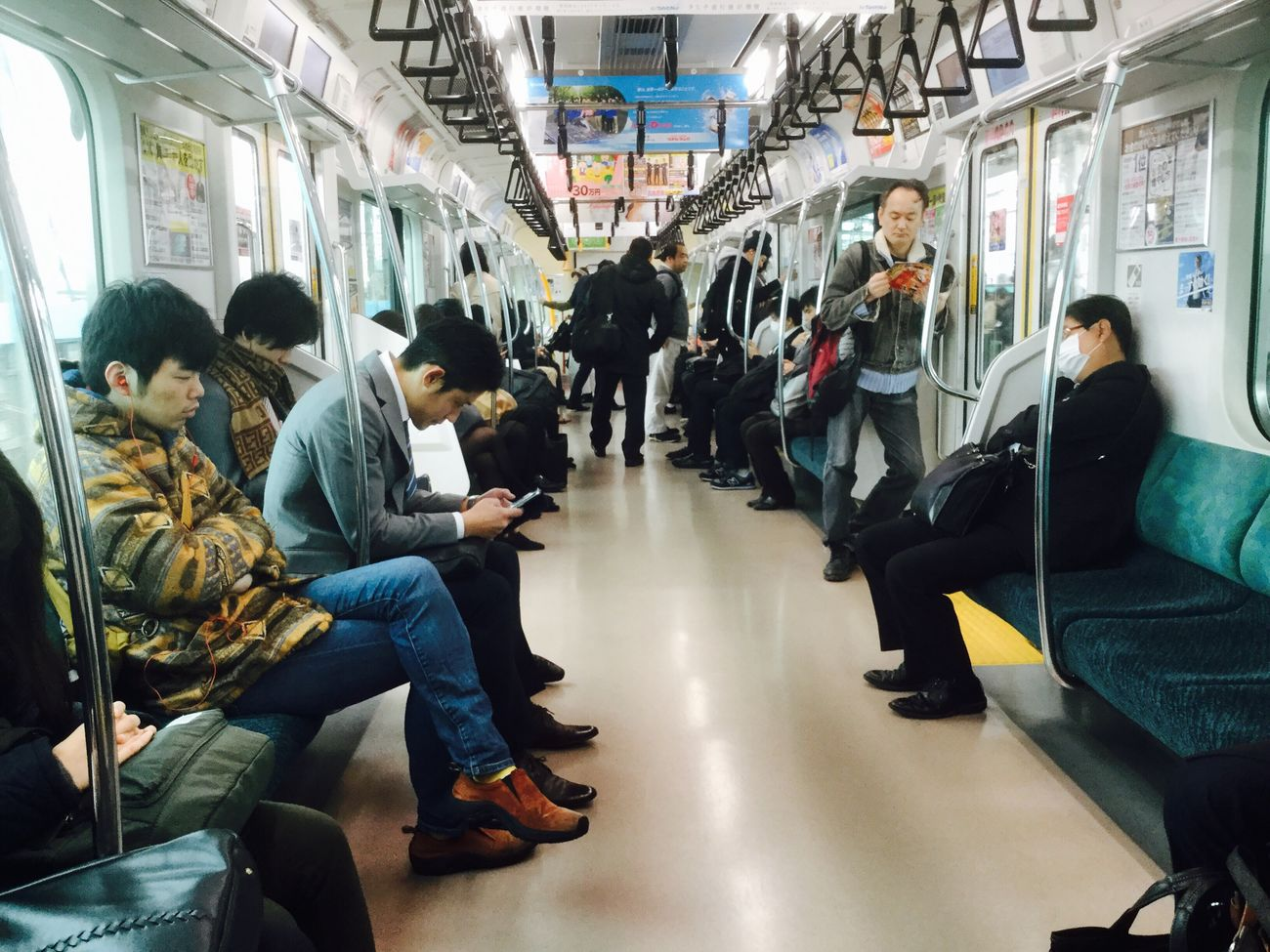 Public Transportation Commuter Subway Train Transportation Train - Vehicle Travel Vehicle Interior Passenger Men Mode Of Transport Commuter Train Train Interior Group Of People Adults Only
