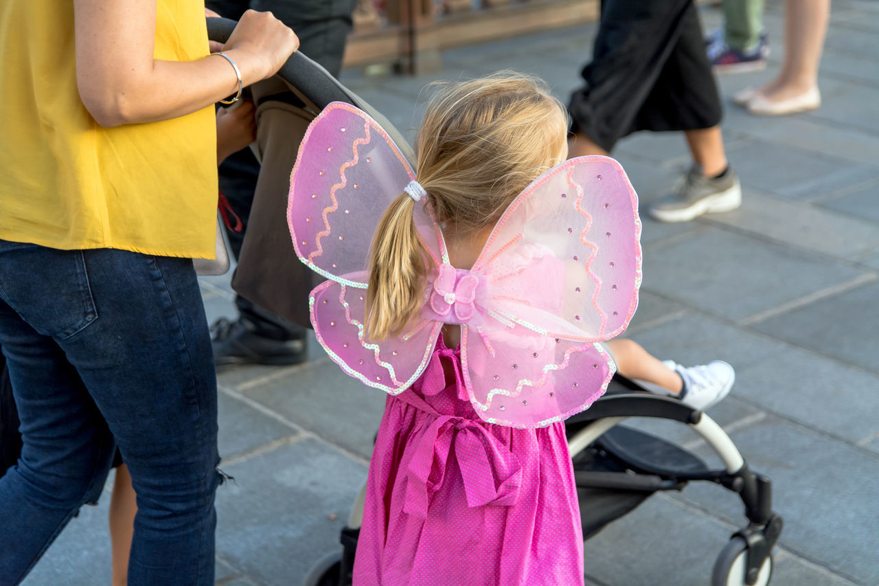 Adult Casual Clothing Child Childhood Children Custom Day Disguise Fairy Friendship Fun Girls Happiness Kid Lifestyle Lifestyles Outdoors People Pink Color Portrait Real People Sidewalk Standing Street Photography Togetherness The Street Photographer - 2017 EyeEm Awards