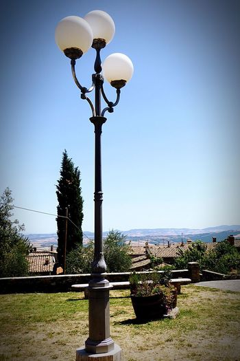 Street Light Clear Sky No People Outdoors Day Sky Architecture Built Structure Blue Nature Building Exterior Tree Grass Beauty In Nature Water Italy🇮🇹 Week On Eyeem Toscana Montepulciano D' Abruzzo The Way I View The World Metal Lamps Streetlamp Glasbowl On Lamp Old But Awesome Old City Lamp