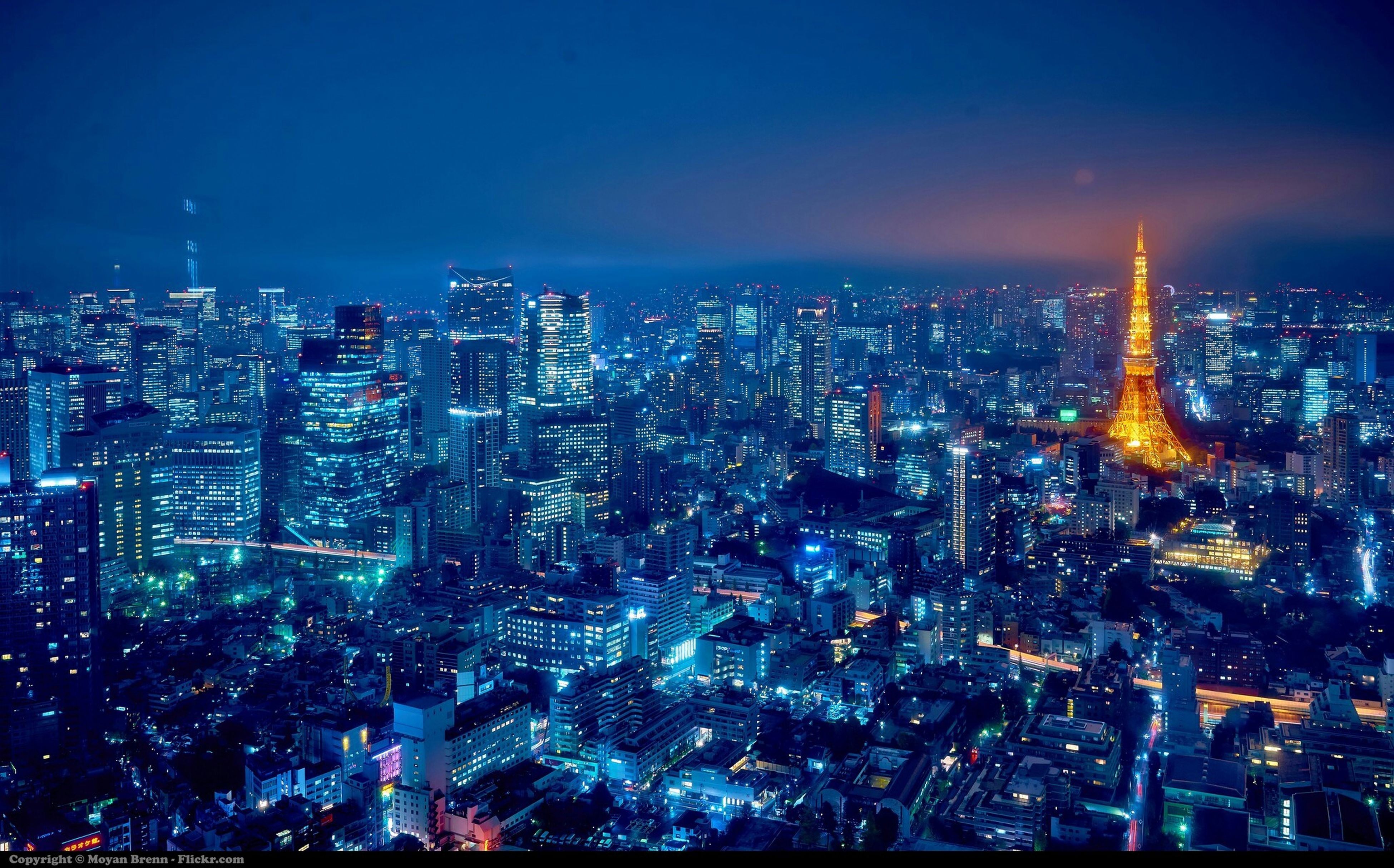 illuminated, cityscape, city, night, building exterior, architecture, built structure, crowded, skyscraper, tower, tall - high, capital cities, aerial view, high angle view, modern, travel destinations, office building, financial district, residential district, sky