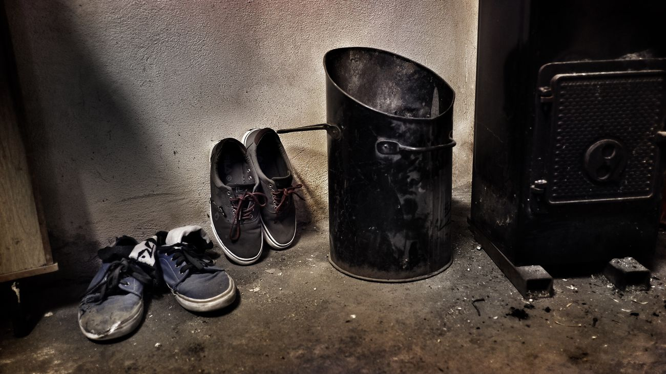 Dirt Indoors  No People Old Shoes Rough Texture Shoe Shoes Skate Shoes Waste Basket Waste Bin Wood Stove
