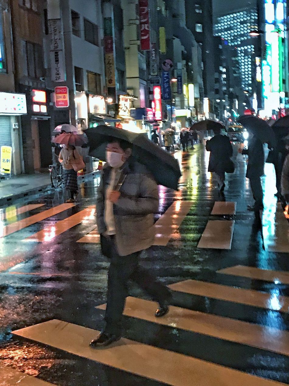 Cities Night Street Wet City Illuminated Blurred Motion Real People Rain Full Length City Life Building Exterior Outdoors Leisure Activity Built Structure Group Of People Architecture Men People Rainy Rainy Days