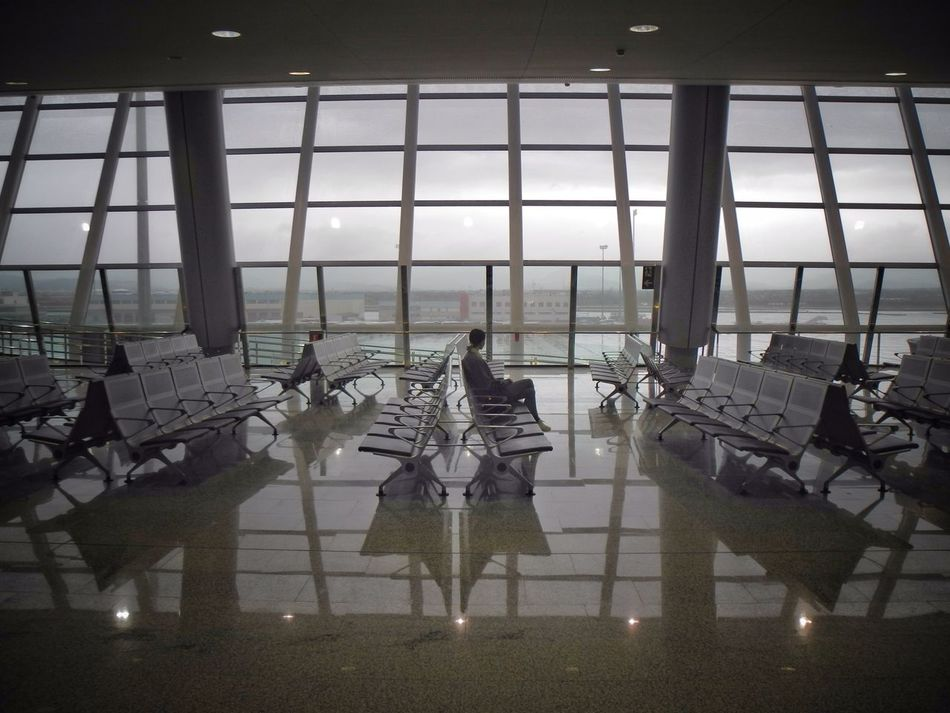 Waiting Alone Waiting Airport Urban Geometry Eye4photography  Perspective From My Point Of View Light And Shadow Geometric Shapes PMI Window Architectural Detail Windows Traveling Travel Travel Photography Travelling