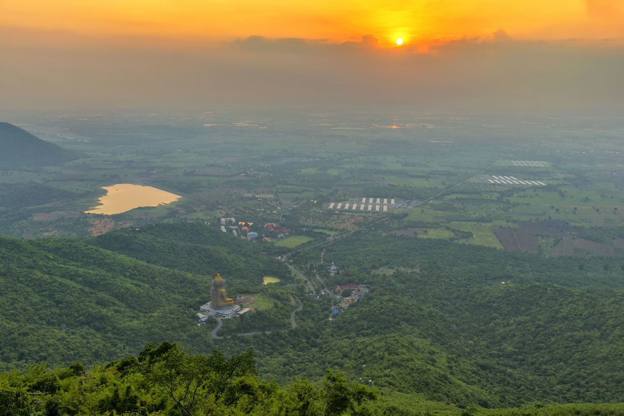 scenics, beauty in nature, sunset, nature, tranquil scene, outdoors, mountain, landscape, tranquility, sky, aerial view, no people, adventure, day, building exterior, tree, cityscape, city