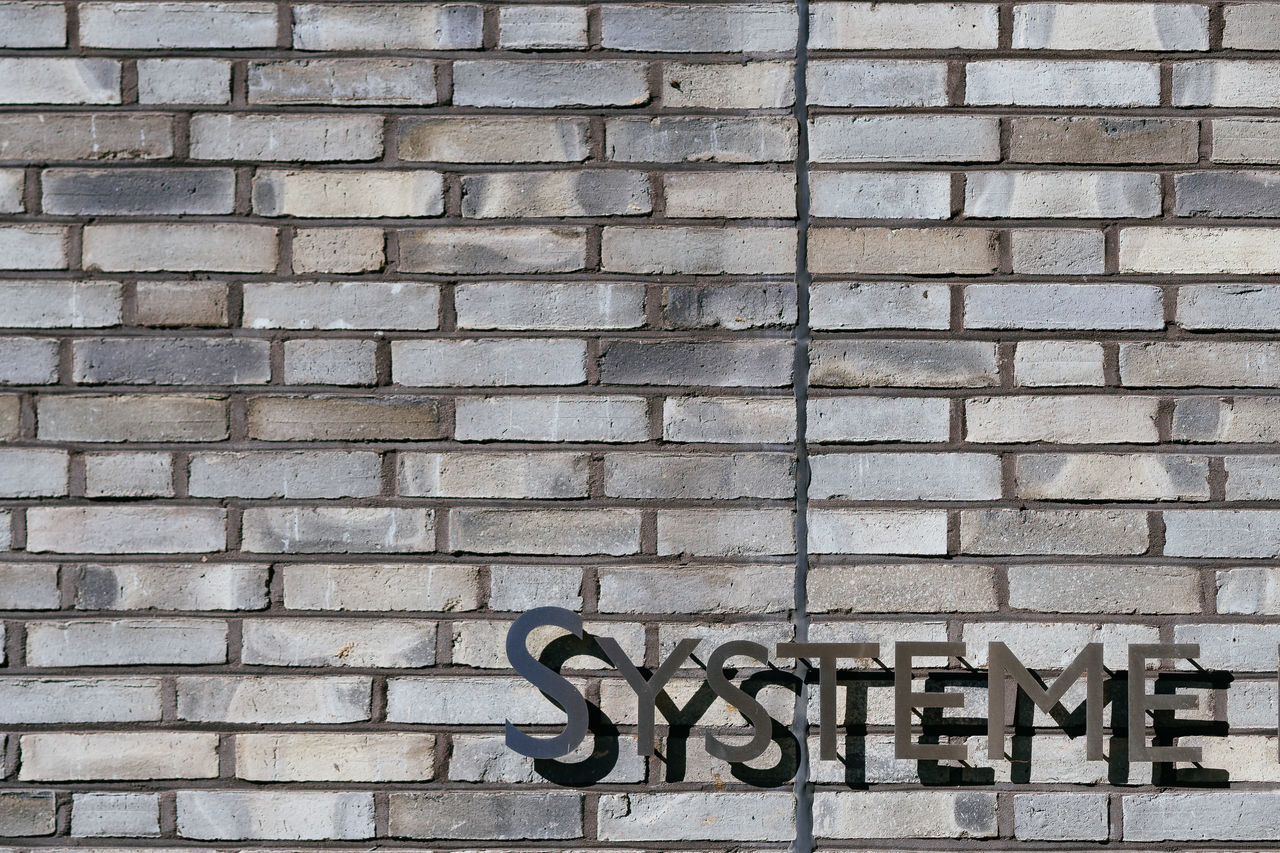 Systeme Architecture Brick Wall Building Exterior Built Structure Day Modern No People Outdoors System Technology Text Word