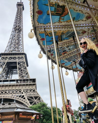 Carousel in Paris One Person Adult Adults Only Travel Destinations People History Low Angle View Outdoors Day Architecture Sky Young Adult City carousel Paris Eiffel Tower carnival