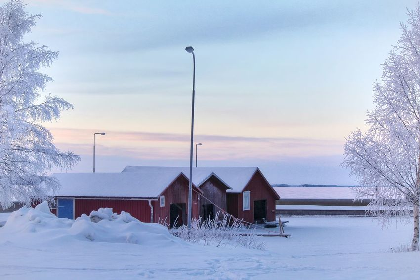Winter scenery by the sea Boathouses Sea EyeEm Selects Snow Cold Temperature Winter Tree Nature Weather Sky Tranquility Tranquil Scene Built Structure No People Scenics Outdoors Beauty In Nature Sunset Shades Of Winter