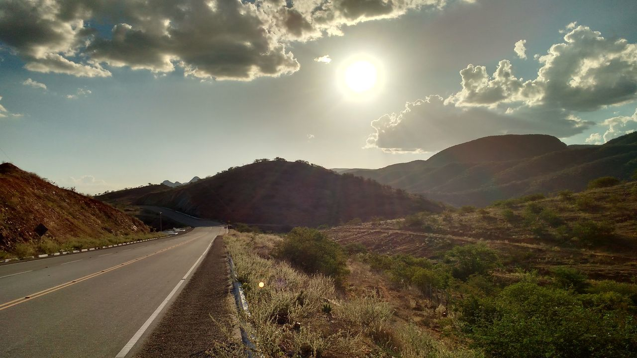 Cloud - Sky Landscape Mountain Sun Outdoors Road Sky The Way Forward Nature Scenics No People Mountain Range Road Trip Rural Scene Beauty In Nature Day Tree Astronomy Galaxy