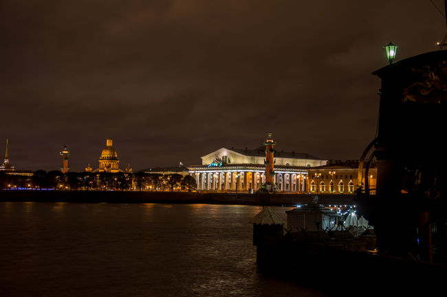 Old Saint Petersburg Stock Exchange and Rostral Columns at night Architecture Building Exterior Built Structure City Cloud Famous Place Famous Places Illuminated Lamp Post Landmarks Night Overnight Success River Sky Tourism Tourist Attraction  Tourist Destination Water Waterfront