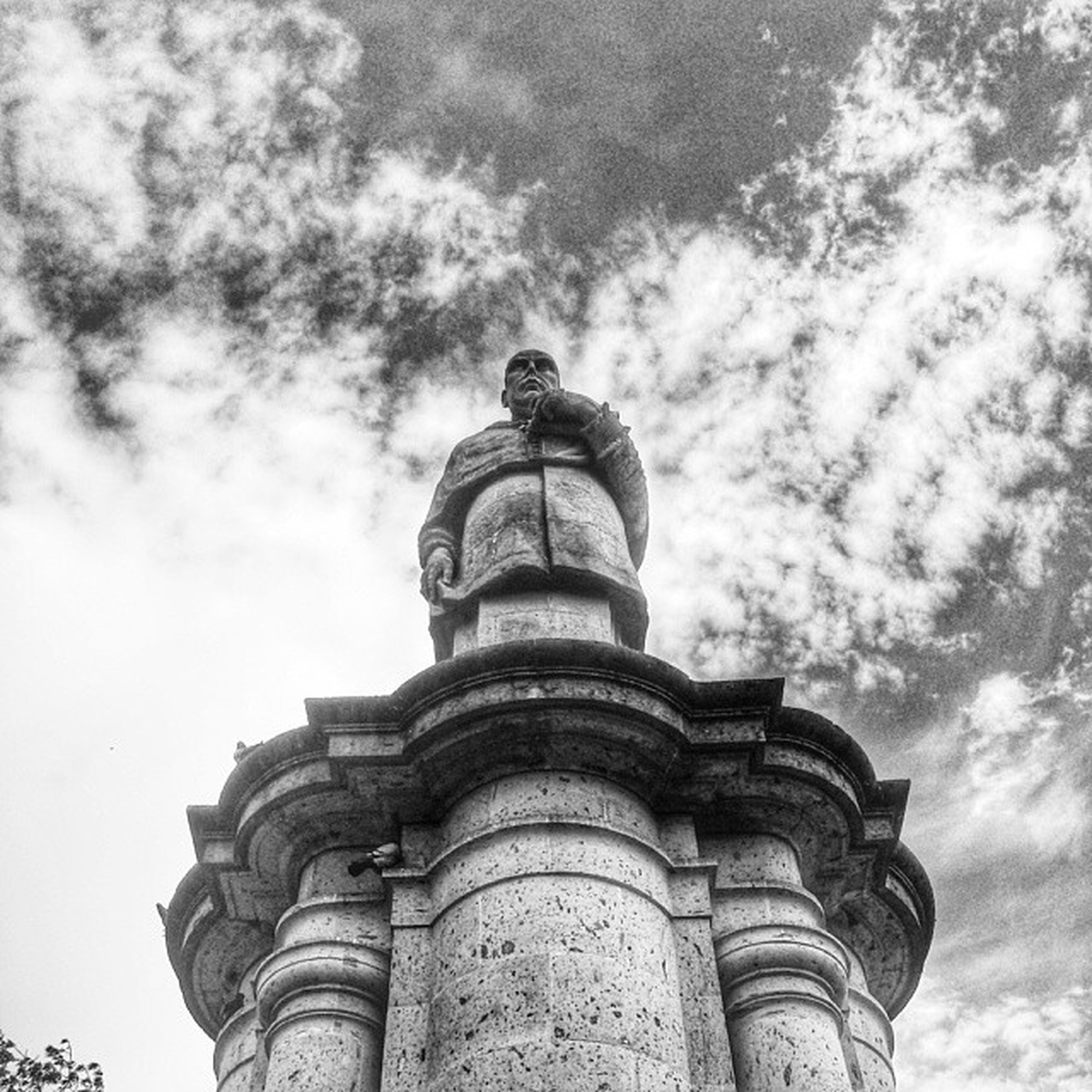 architecture, low angle view, built structure, building exterior, sky, famous place, history, statue, sculpture, travel destinations, cloud - sky, tourism, travel, international landmark, human representation, art and craft, capital cities, architectural column, cloud, religion