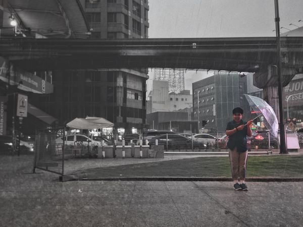 City Lifestyles Built Structure One Person Real People Leisure Activity Outdoors City Life People Kids Kids Being Kids Kidsphotography Rain Rainy Days Colourplay EyeEmNewHere EyeEmNewHere