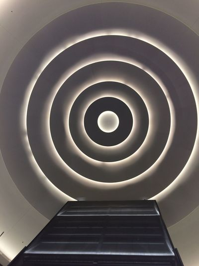 Architectural Feature Architecture Building Built Structure Ceiling Directly Below Elevators Geometric Shape Illuminated Indoors  Low Angle View Modern Pattern Shopping Mall