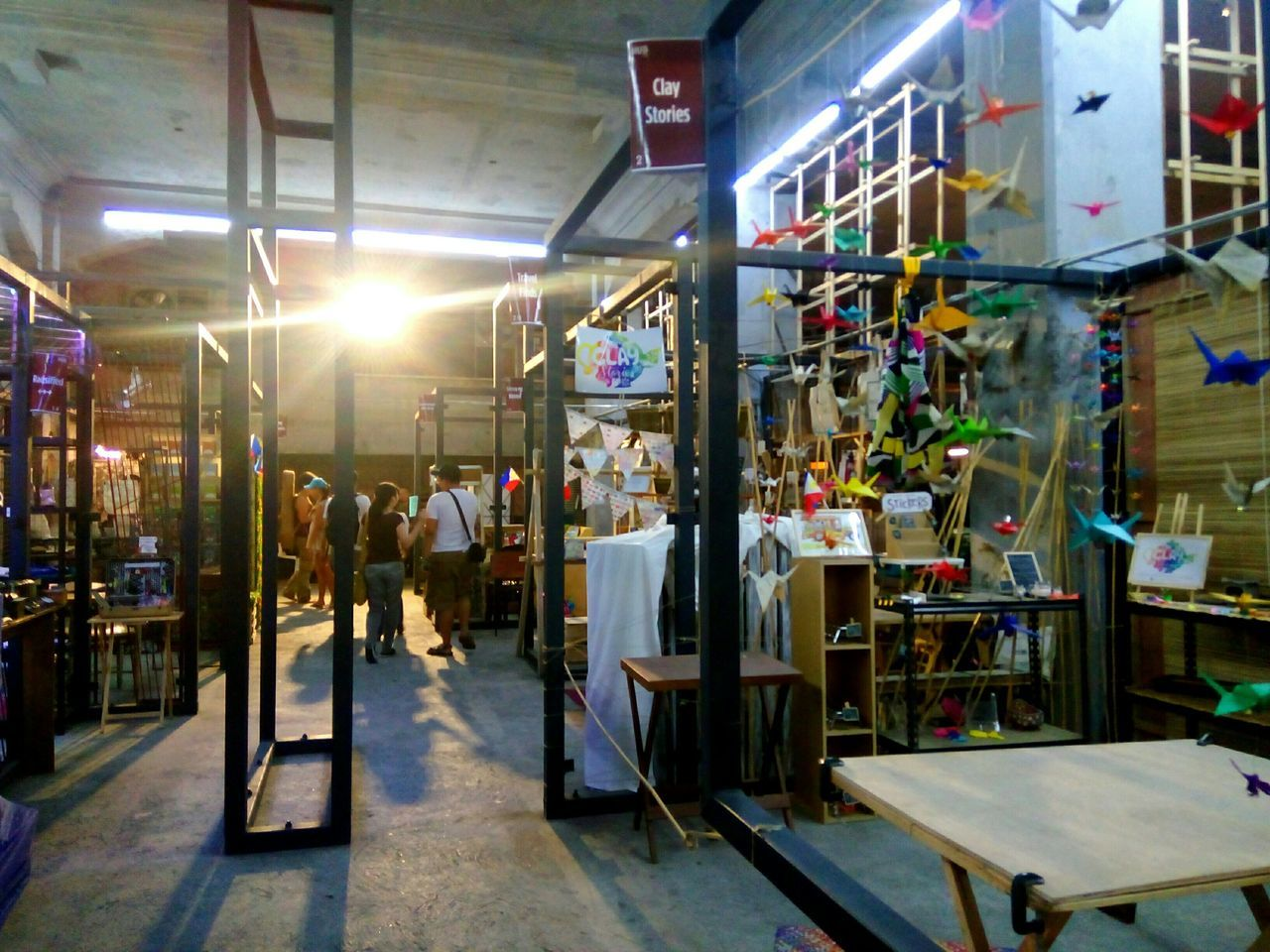 indoors, illuminated, built structure, real people, architecture, factory, day