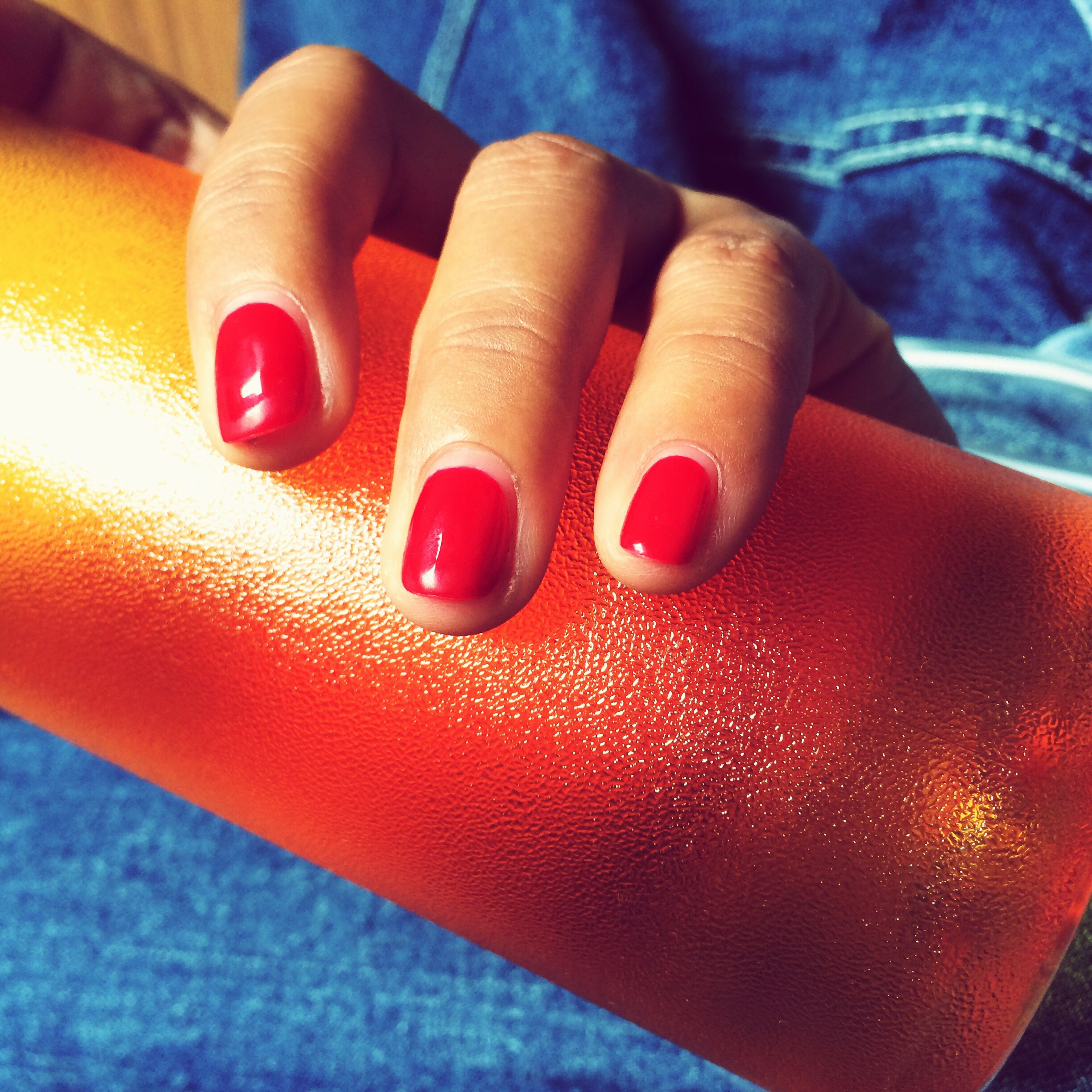 indoors, person, red, part of, close-up, high angle view, multi colored, unrecognizable person, cropped, holding, food and drink, low section, still life, selective focus, table, human finger