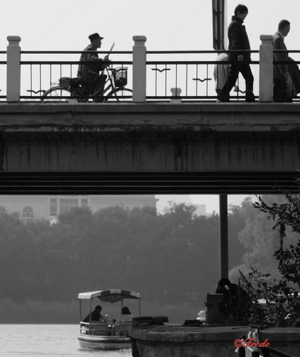 Quiet day Transportation Bridge - Man Made Structure Built Structure Mode Of Transport City Waterfront Water Outdoors Day Person Eye4photography  China In My Eyes My Beijing 2016 Street Photos😄📷🏫⛪🚒🚐🚲⚠ Street Photography BEIJING北京CHINA中国BEAUTY Chaoyang Park Chaoyang Park Lake Lifestyles People And Places.