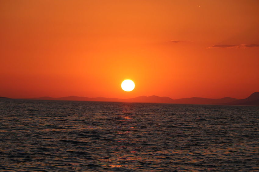 Sunset Sun Orange Color Sea Beauty In Nature Scenics Dramatic Sky Nature Outdoors Tranquil Scene Idyllic No People Tranquility Horizon Over Water Sky Sunlight Landscape Awe Water Travel