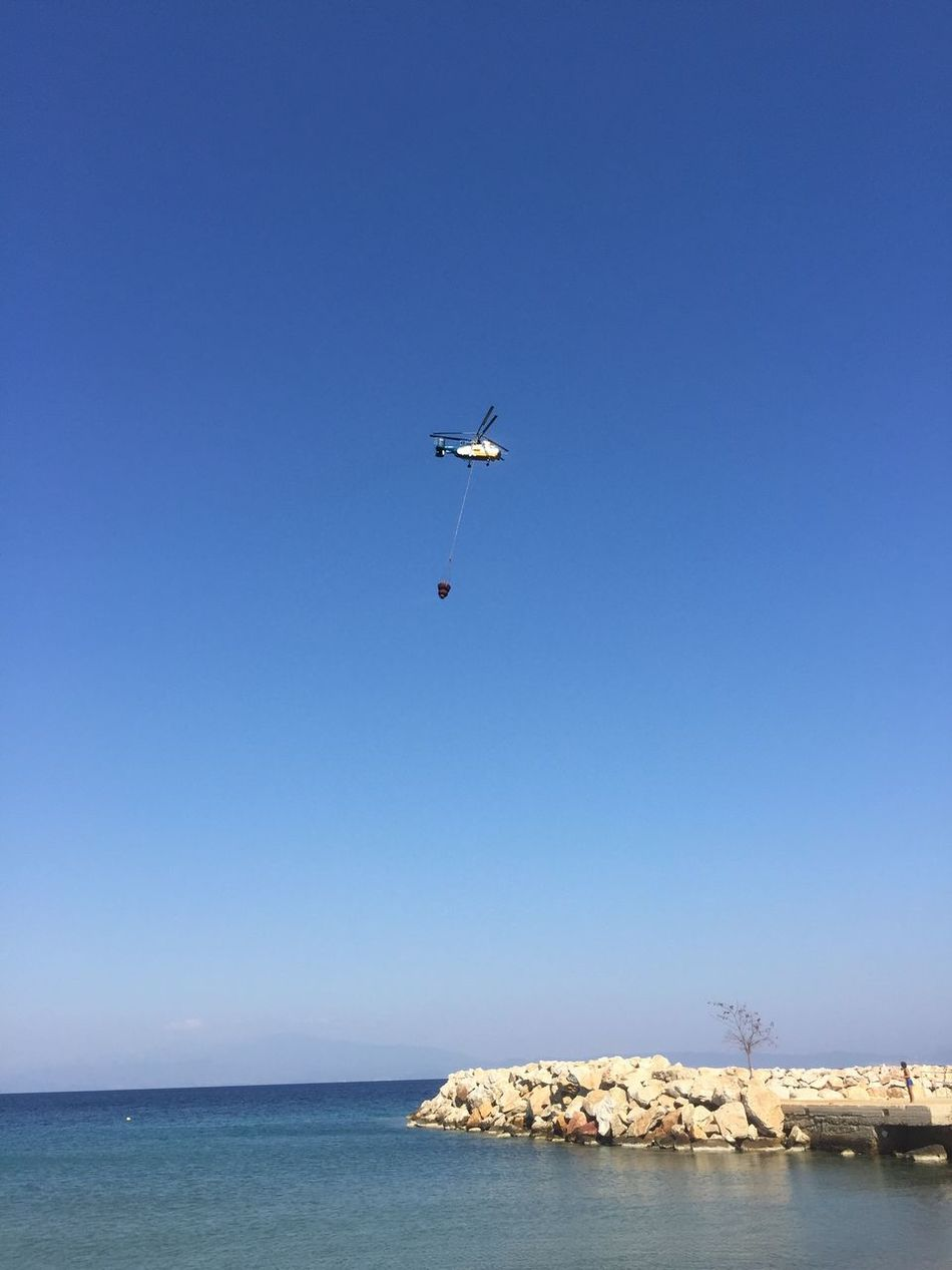 Friend in need is friend indeed. Greece Photos Thassos Island Helicopter FireFighting  Transportation Clear Sky Blue Waterfront Flying Sea