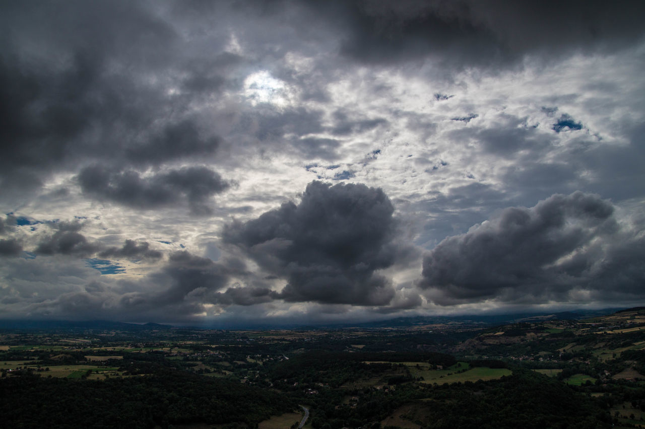 cloud - sky, sky, nature, weather, beauty in nature, no people, tranquility, tranquil scene, scenics, outdoors, storm cloud, landscape, day, awe, tree, thunderstorm