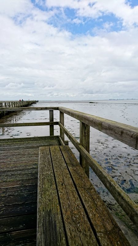 Butjadingen Sea Beach Pier Water Wood - Material Cloud - Sky No People Tranquility Outdoors Horizon Over Water Day Vacations Nature Jetty Sky Sand Scenics Beauty In Nature Travel Destinations Harbor