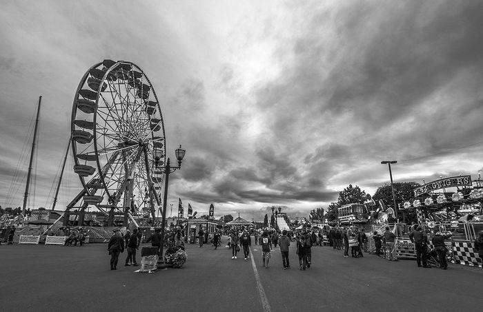 Ominous day at the Washington State Fair Washington State Fair Amusement Park Arts Culture And Entertainment Blackandwhite Built Structure Cloud - Sky Crowd Day Fairground Ferris Wheel Gloomy Large Group Of People Leisure Activity Monochrome Outdoors People Real People Sky EyeEmNewHere