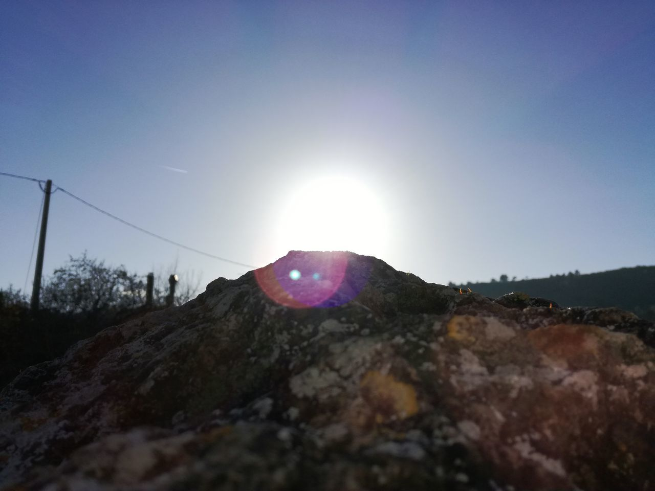 sun, lens flare, sunbeam, sunlight, nature, mountain, clear sky, outdoors, landscape, beauty in nature, sky, day, no people