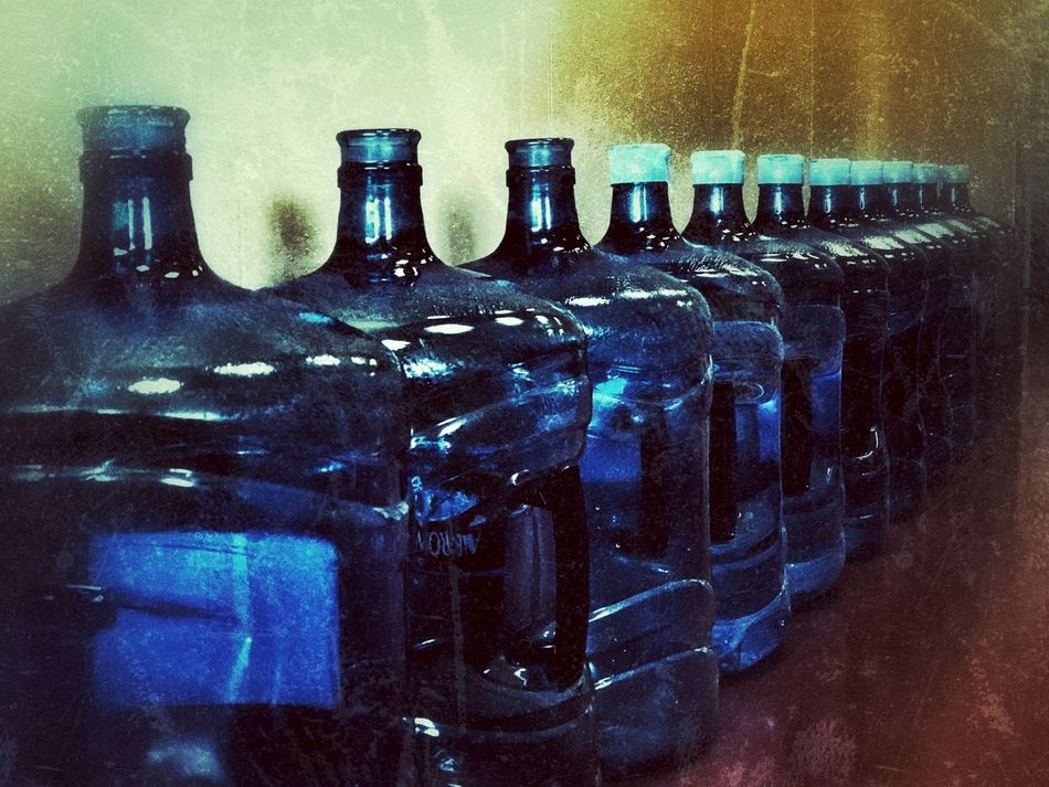 In A Row Water Bottle Jars Lining Up Plastic Containers Queue Pattern