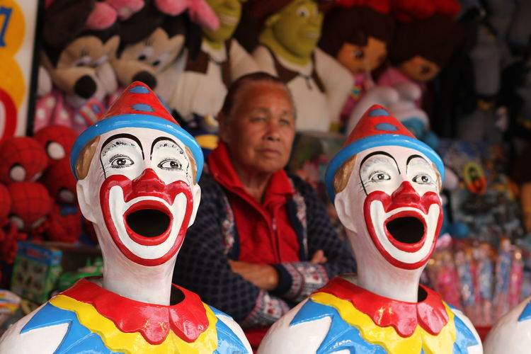 Close-up Clowns Focus On Foreground Outdoors Portrait Toys Traralgon Show Groun Woman Far Background Thinki