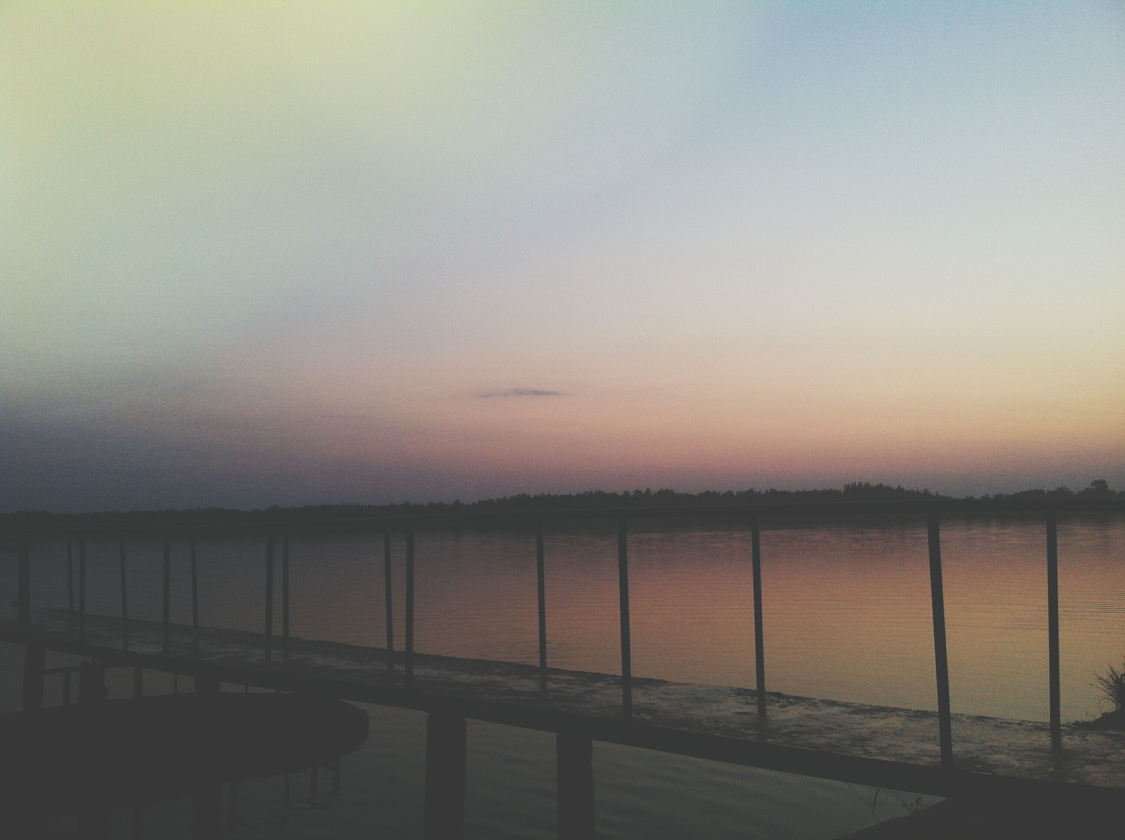 water, sunset, sea, tranquil scene, tranquility, railing, scenics, horizon over water, sky, copy space, beauty in nature, nature, clear sky, built structure, idyllic, pier, outdoors, no people, lake, calm