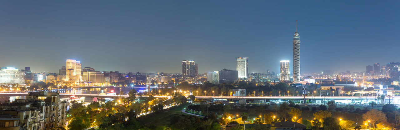 Panoramic view of central Cairo skyline at night. Aerial Africa Arab World Architecture Building Exterior Cairo City Cityscape Downtown Egypt Illuminated Middle East Modern Night Night Lights North Africa Outdoors Panorama Panoramic Skyscraper Urban Zamalek