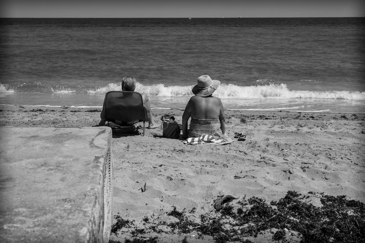 Love is a Beach Adults Only Beach Beauty In Nature Blackandwhite Photography Bonding Day Friend Friendship Horizon Over Water Leisure Activity Lifestyles Nature Outdoors People Photographyisthemuse Real People Rear View Sand Sea Togetherness Two People Vacations Wanderlust Water Women