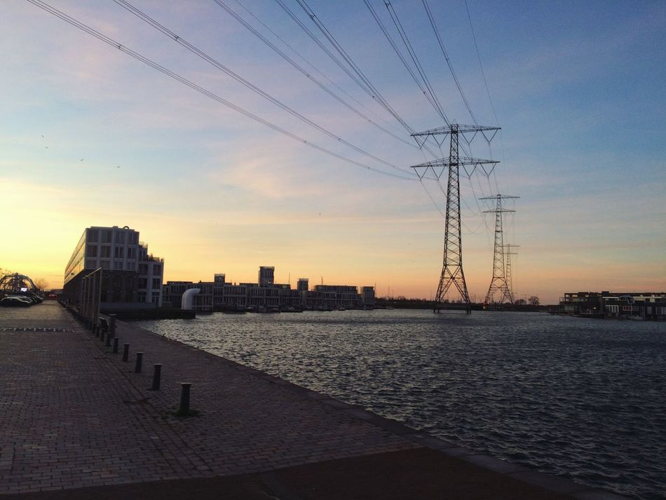 Sky Sunset Architecture Building Exterior City Built Structure Electricity  Power Line  Outdoors Water No People Cable Power Supply Electricity Pylon Connection Cloud - Sky Day Nature