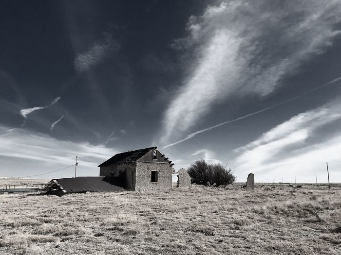 """""""Mystery Ranch No. 15"""" The Collapse. New Mexico Photography New Mexico Skies New Mexico Collapsed Building Old Buildings Abandoned Buildings Abandoned Places Abandoned Built Structure Architecture Sky Building Exterior Field No People Outdoors Cloud - Sky"""