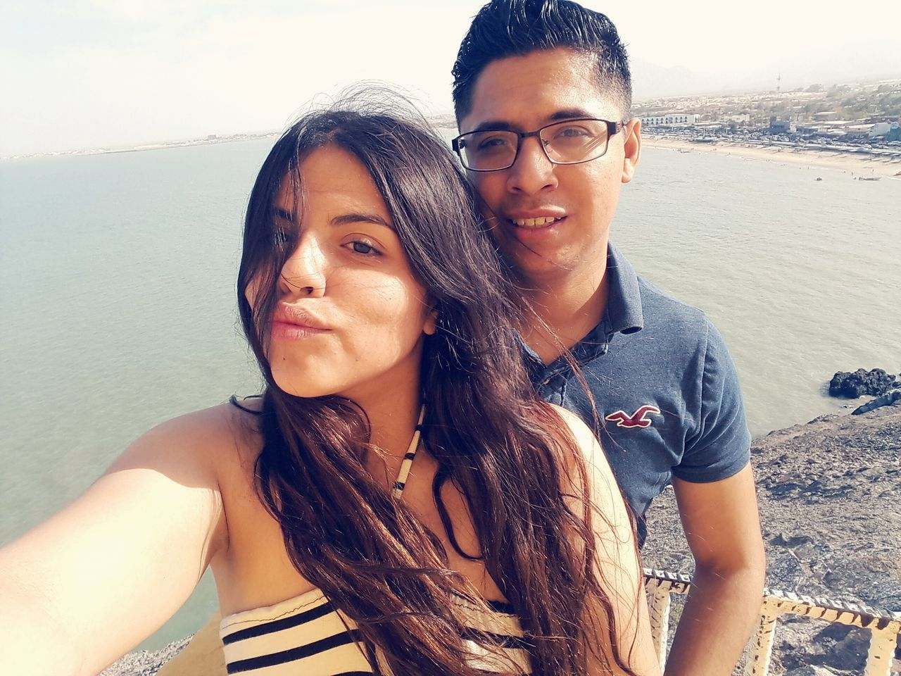 two people, young adult, looking at camera, young women, portrait, real people, smiling, togetherness, leisure activity, front view, happiness, outdoors, lifestyles, beach, young men, love, beautiful woman, nature, day, beauty in nature, sea, vacations, eyeglasses, bonding, water