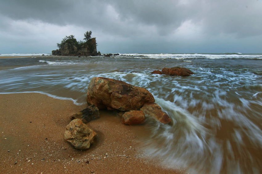 Rock - Object Rock Island Cloud - Sky Landscape Dramatic Sky Rock - Object Sand Outdoors Wave Nature No People Tranquility Sky Beauty In Nature Water Horizon Over Water