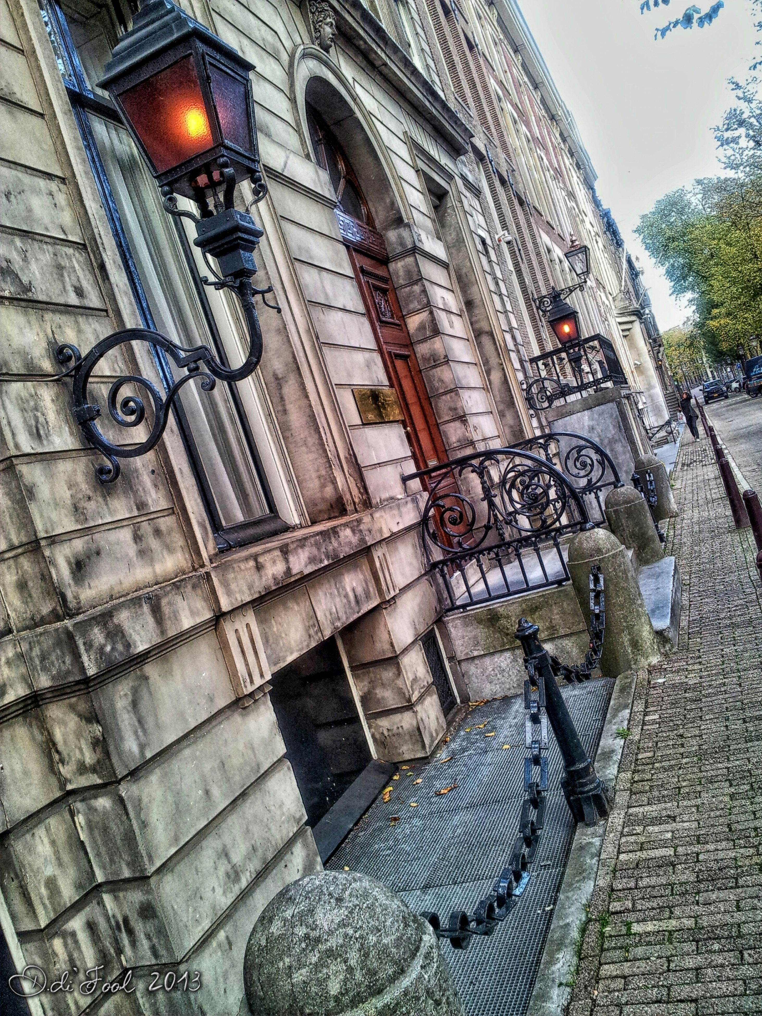 architecture, built structure, building exterior, cobblestone, arch, day, outdoors, street, building, city, sunlight, old, paving stone, no people, sidewalk, railing, footpath, steps, wall - building feature, history