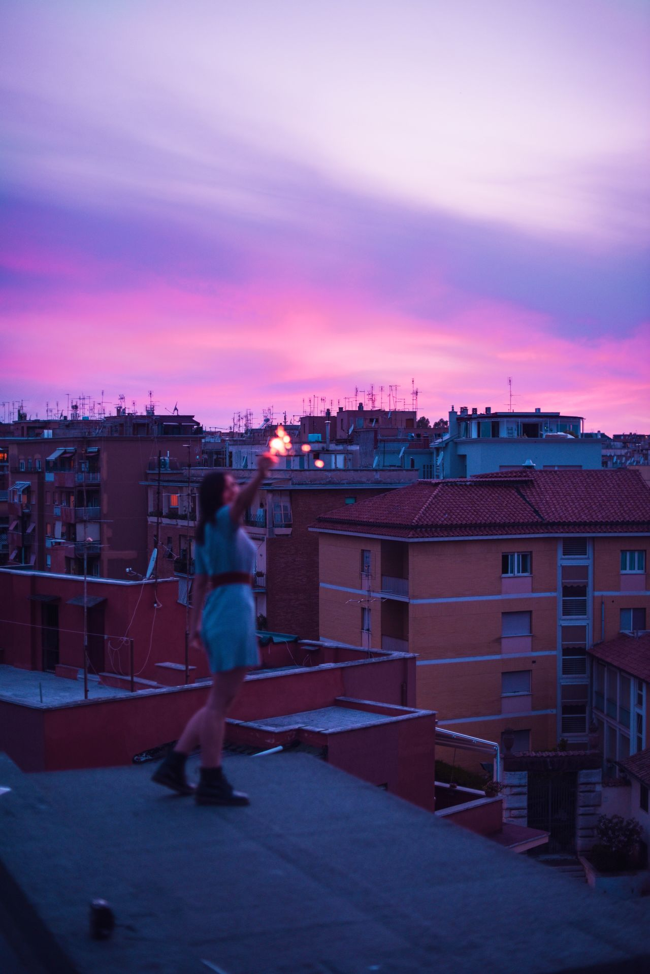 Out of focus Building Exterior Built Structure Architecture Sky Sunset One Person City Full Length Cityscape Leisure Activity Cloud - Sky Outdoors Lifestyles Illuminated Real People Roof Nature People Young Adult One Man Only