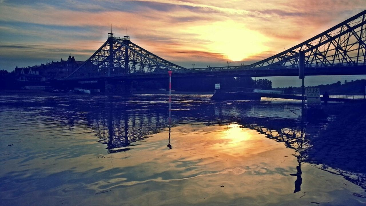 bridge - man made structure, sky, water, connection, sunset, built structure, architecture, cloud - sky, river, reflection, transportation, suspension bridge, outdoors, travel destinations, no people, nature, beauty in nature, city, day