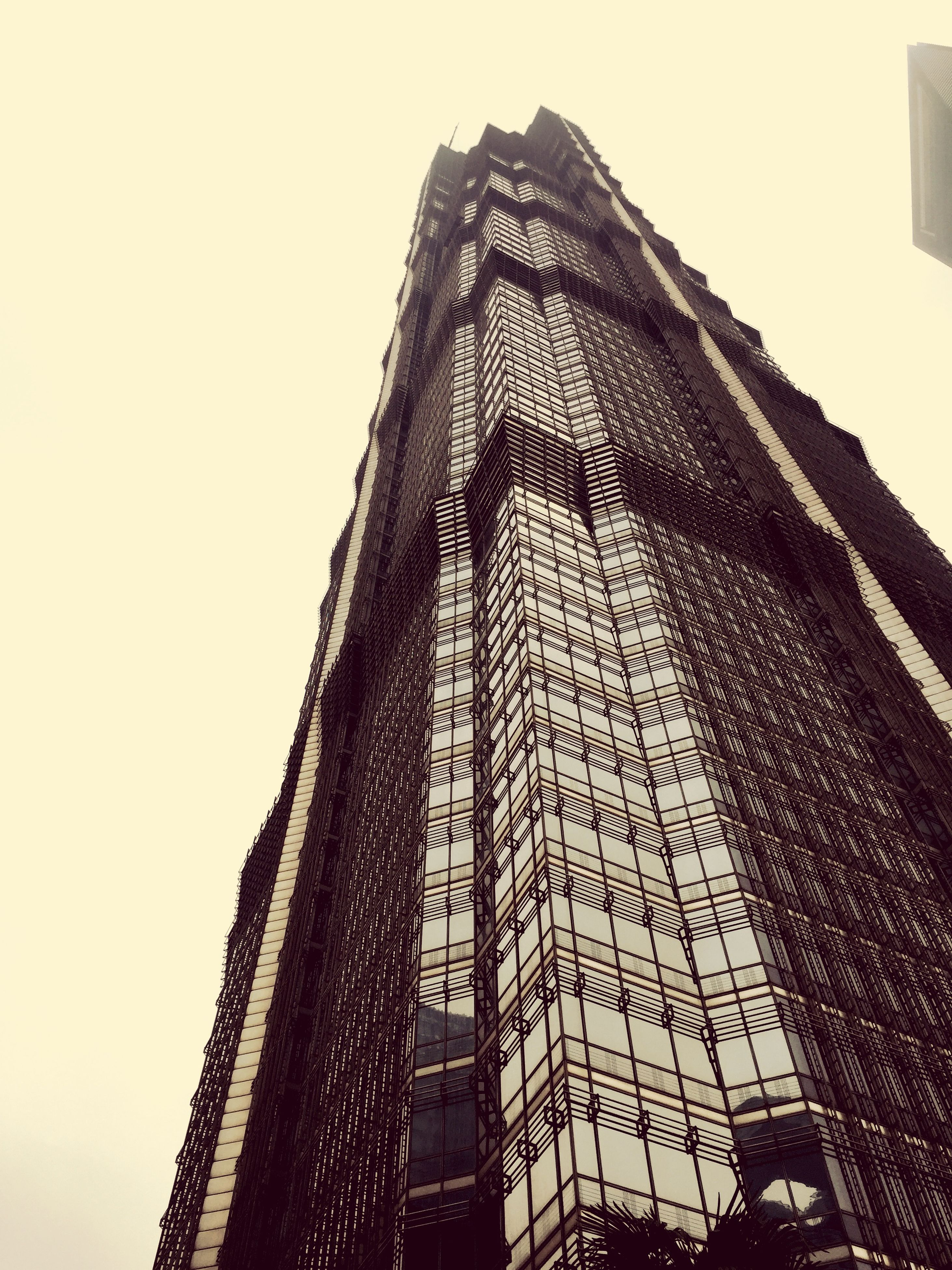 building exterior, architecture, built structure, low angle view, clear sky, city, tower, skyscraper, tall - high, modern, building, office building, sky, outdoors, day, no people, copy space, window, tall, pattern