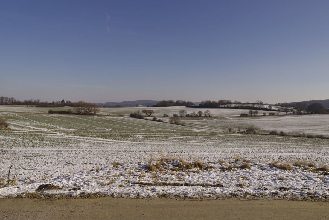 Landscape with rests of snow Agriculture Beauty In Nature Cold Temeperat Day Farm Landscape Nature No People Outdoors Rural Scene Sky Snow Winter