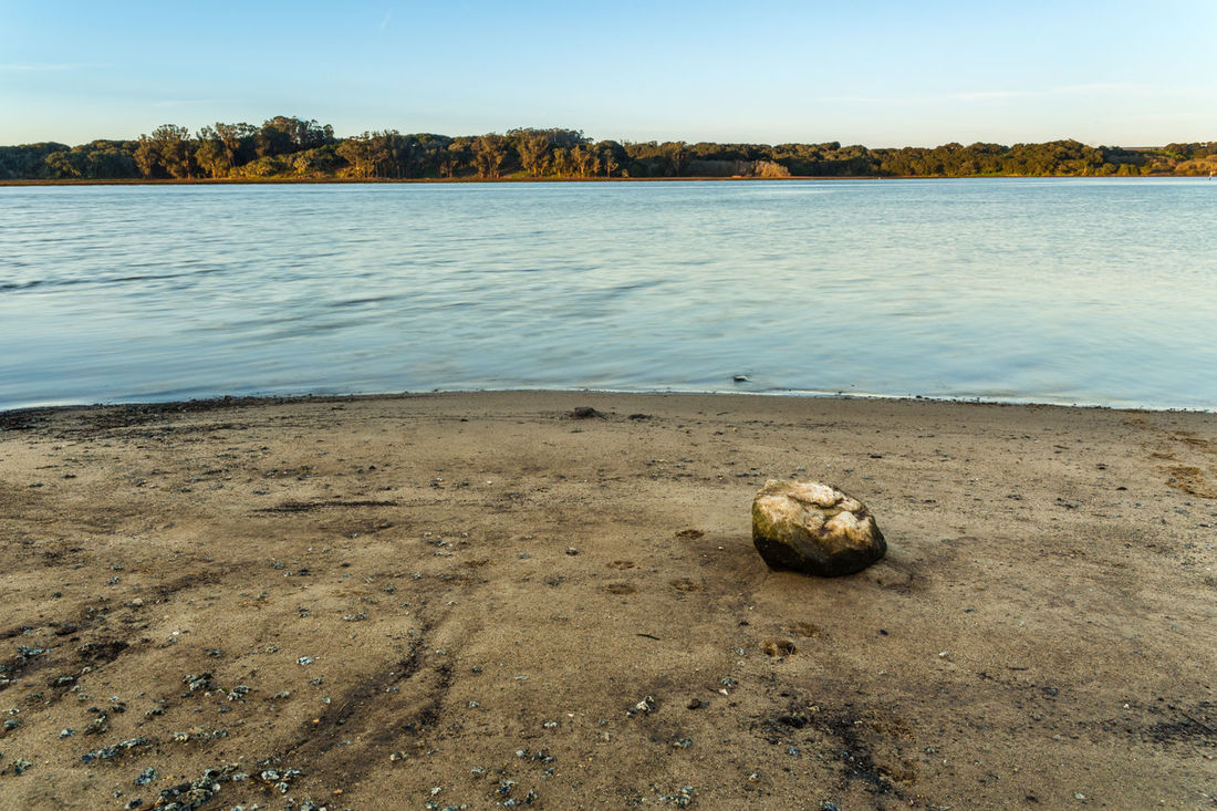 Beach Beauty In Nature Day Foreground Focus Horizon Landscape Nature No People Outdoors Rock Sand Sky Trees And Sky Water
