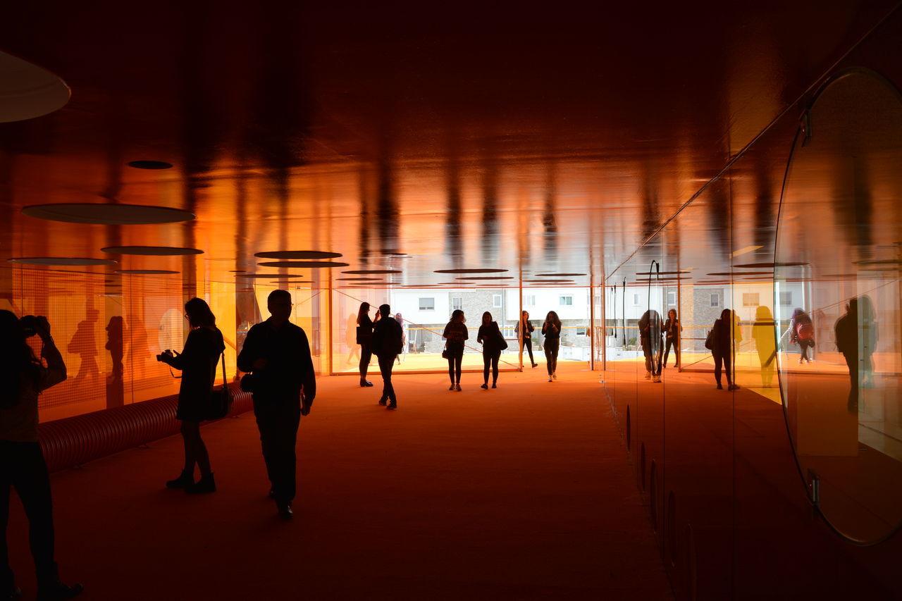 sunset, large group of people, indoors, men, illuminated, architecture, day, people