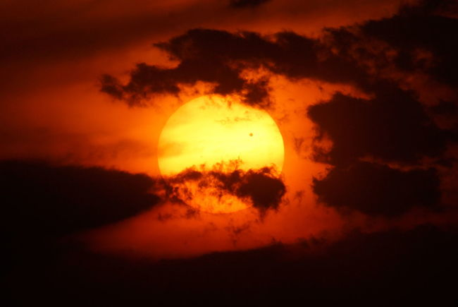 Venus Transit Back Lit Beauty In Nature Cloud Cloud - Sky Cloudscape Cloudy Dark Dramatic Sky Idyllic Low Angle View Majestic Moody Sky Nature No People Orange Color Outdoors Scenics Sky Sky Only Sun Sunset Tranquil Scene Tranquility Venus Transit Weather